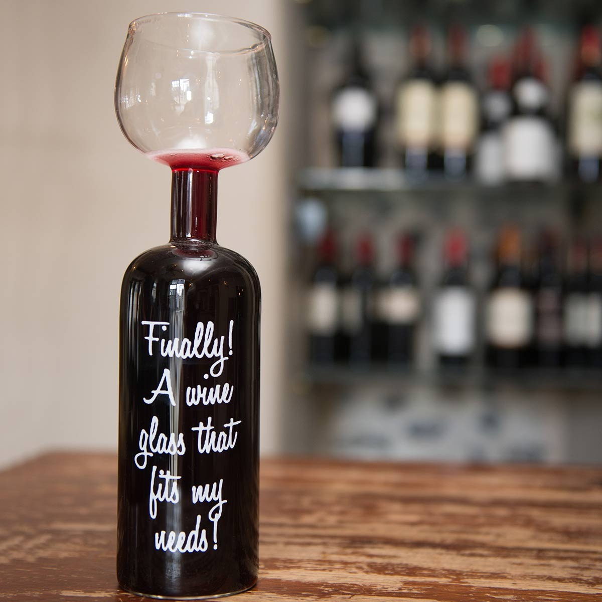 The Wine Bottle Glass Holds A Whole Bottle The Present
