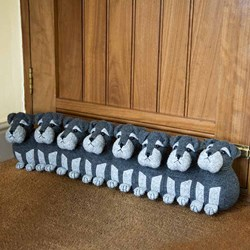 Eight Puppies Draught Excluder | what a team to keep you warm!